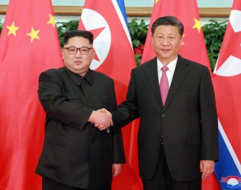 Photo Exhibition: Supreme Leader Kim Jong Un Meets President Xi Jinping - Image